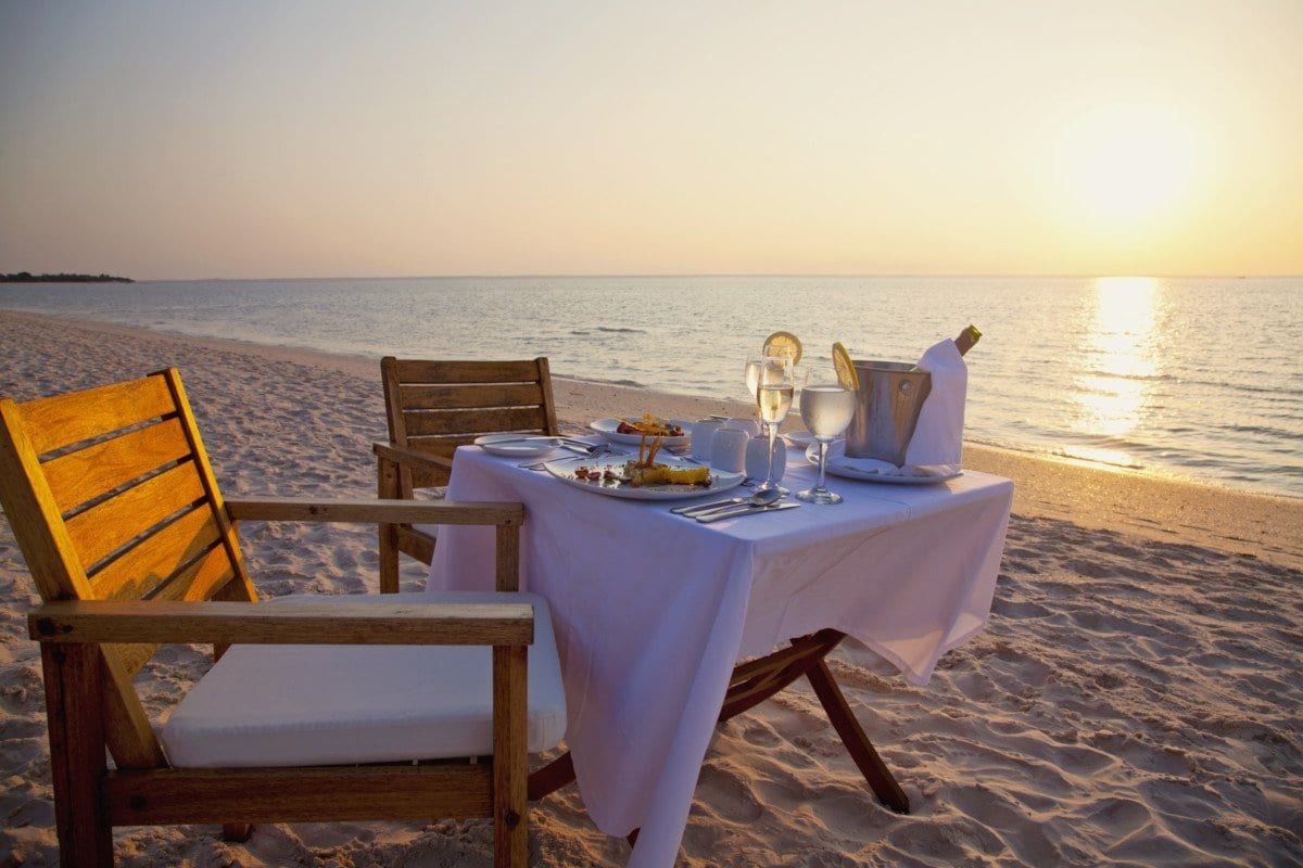 Azura Benguerra dinner set up on beach at sunset